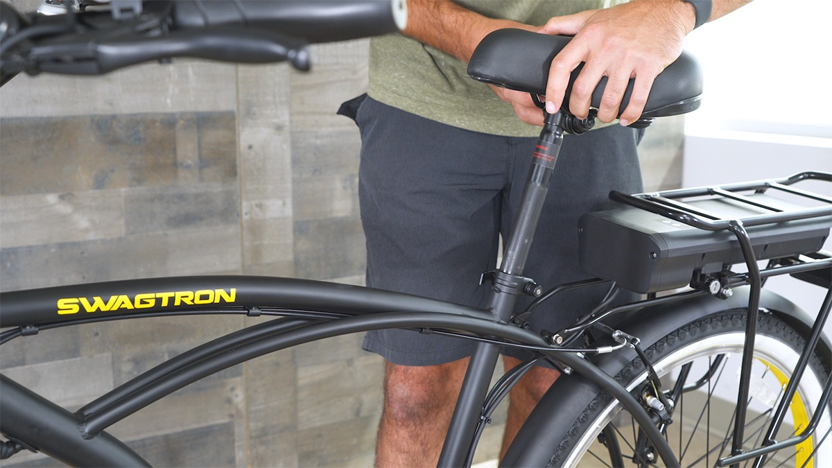 Close-up of man adjusting the seat height on the EB11