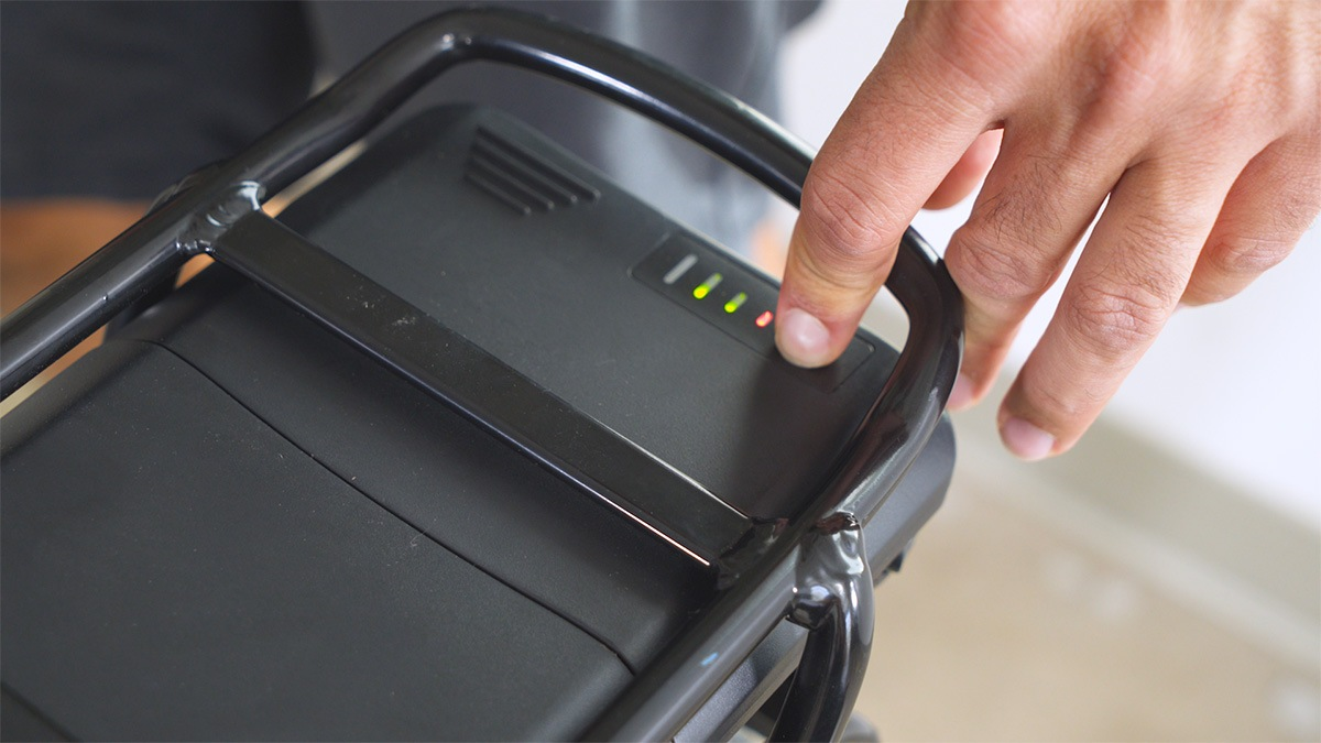 Close-up of man pressing turning on the EB11's battery power.