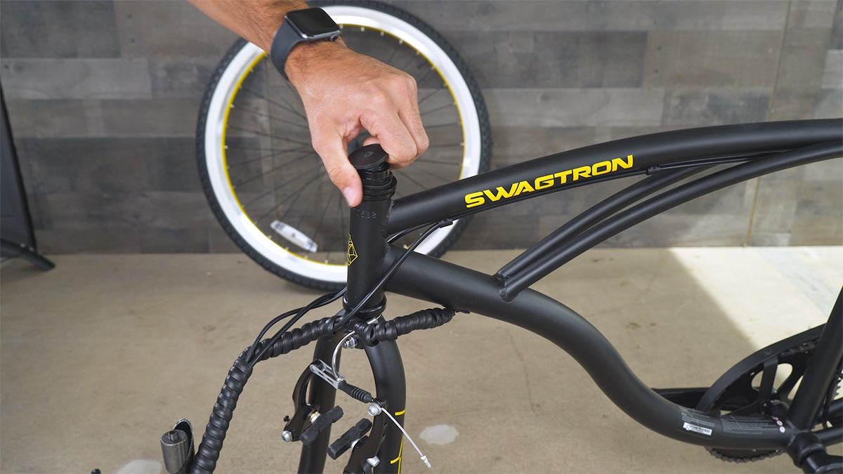 Close-up of man removing the top-cap from the handlebar stem