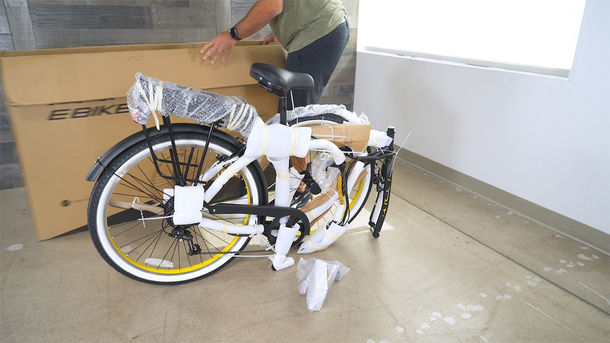 Close-up of man removing the EB11 from its packaging