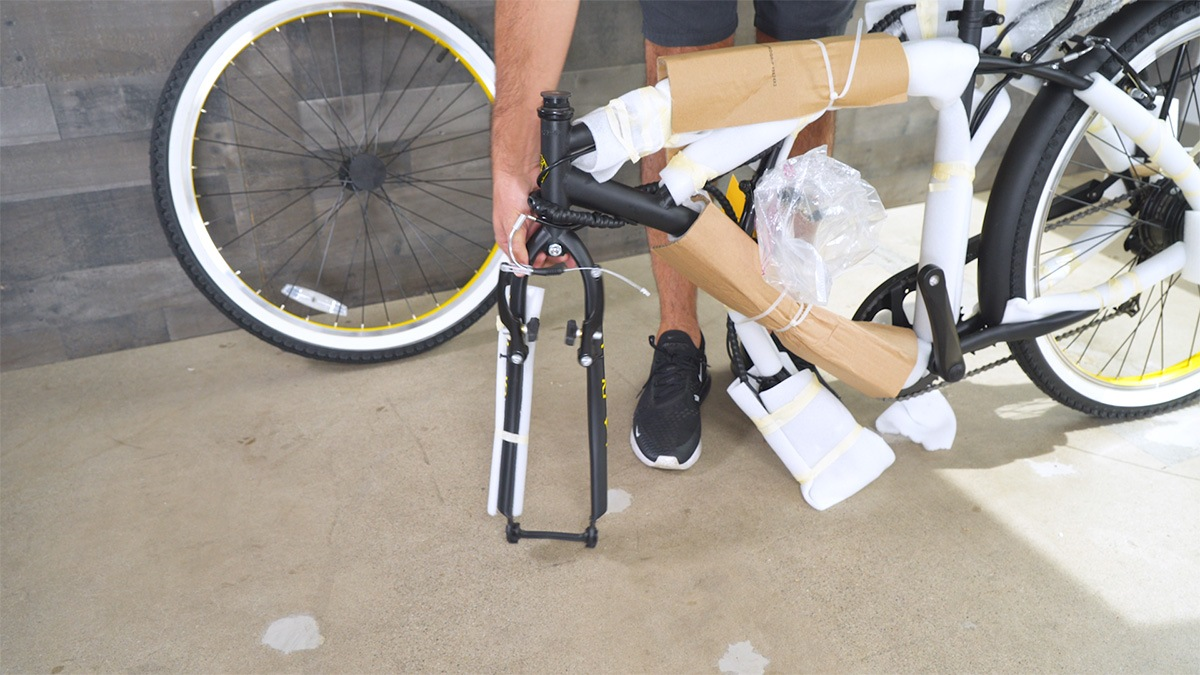 Close-up of man rotating the EB11's front fork while it's upside-down