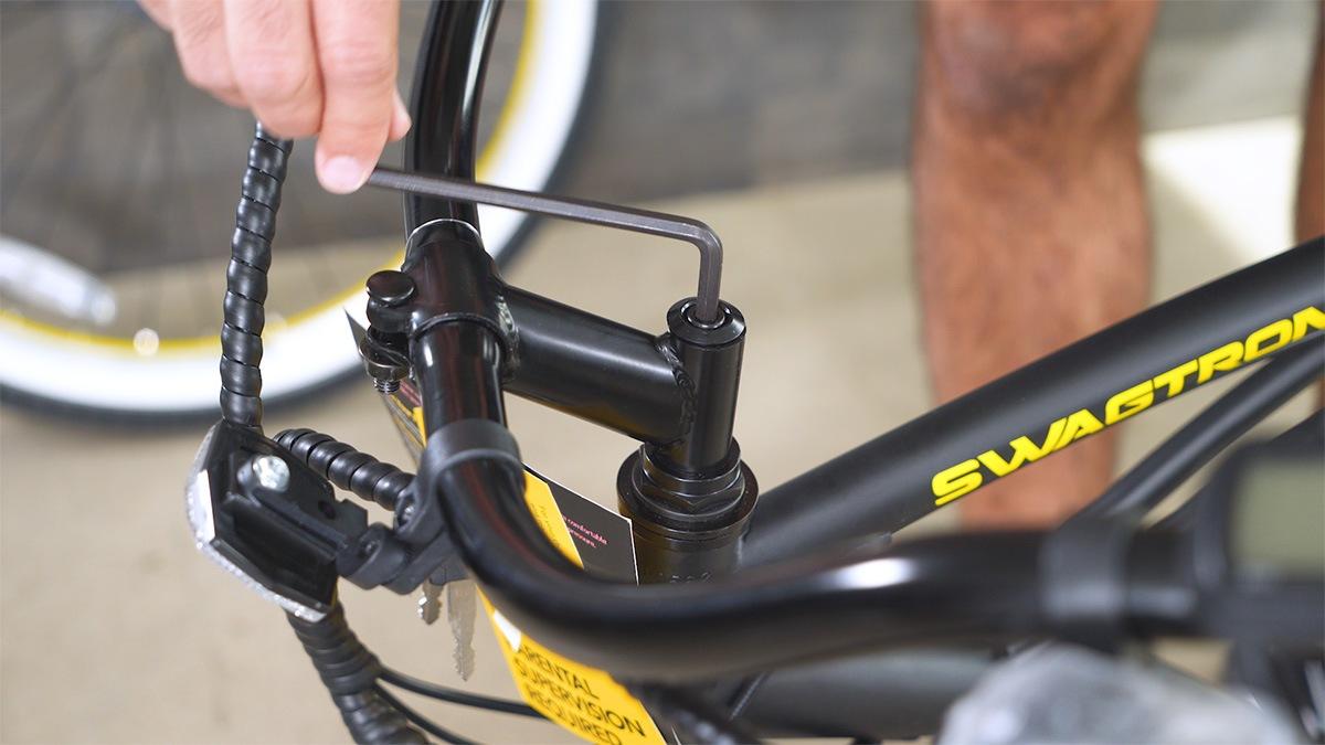 Close-up of man tightening handlebar