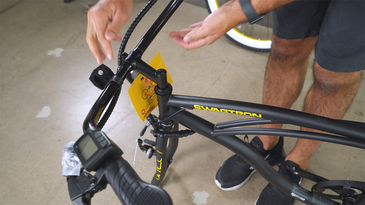 Close-up of man inserting the handlebar into the EB11