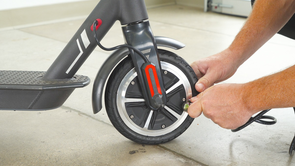 Close-up of guy checking the tire pressure of the SG5 front tire