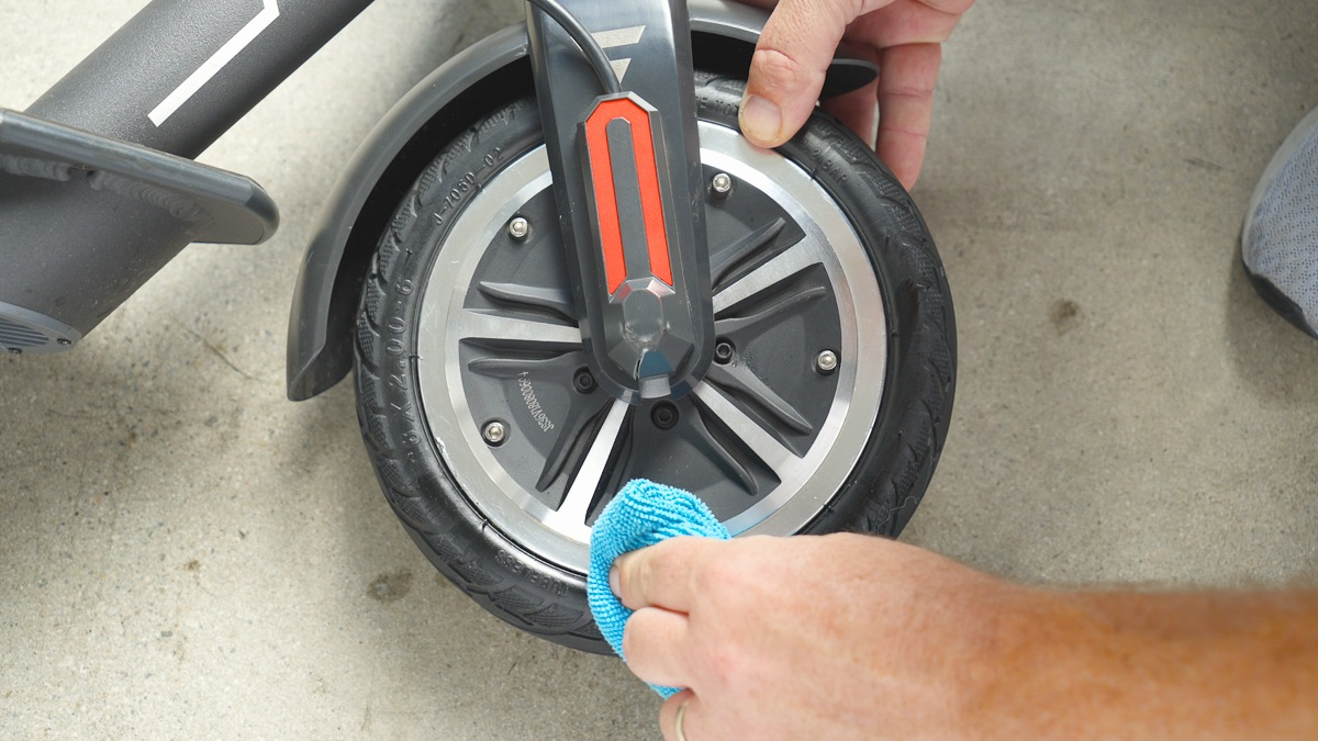 Close-up of guy wiping down the tire after successfully repairing the tire