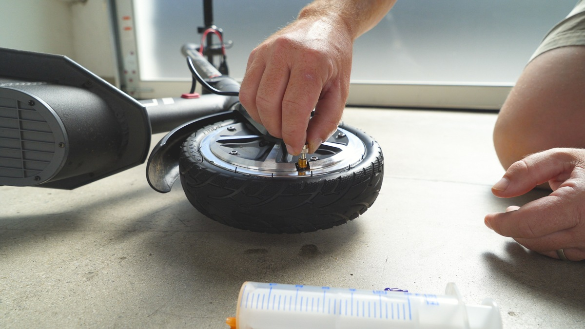 Reinserting the valve on the Swagger 5 Elite's front tire