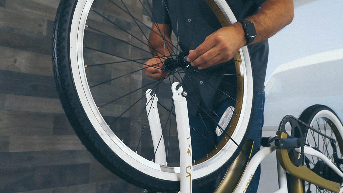 Close-up of man attaching the front wheel of the EB10.