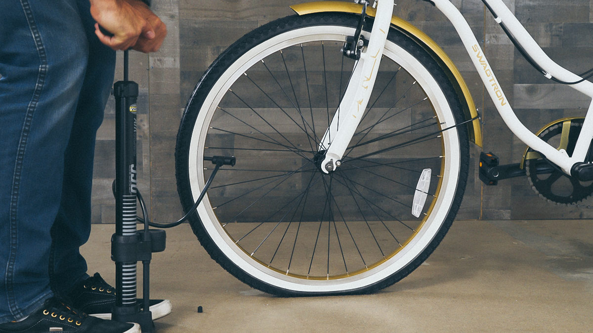 Close-up of man inflating the EB10 front tire.