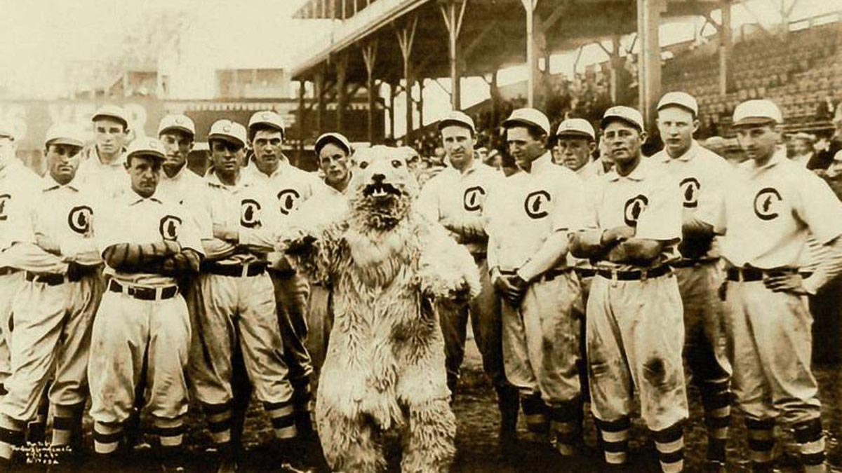 Vintage photo of early Chicago Cubs team with the original guy-in-a-bear-suite mascot.