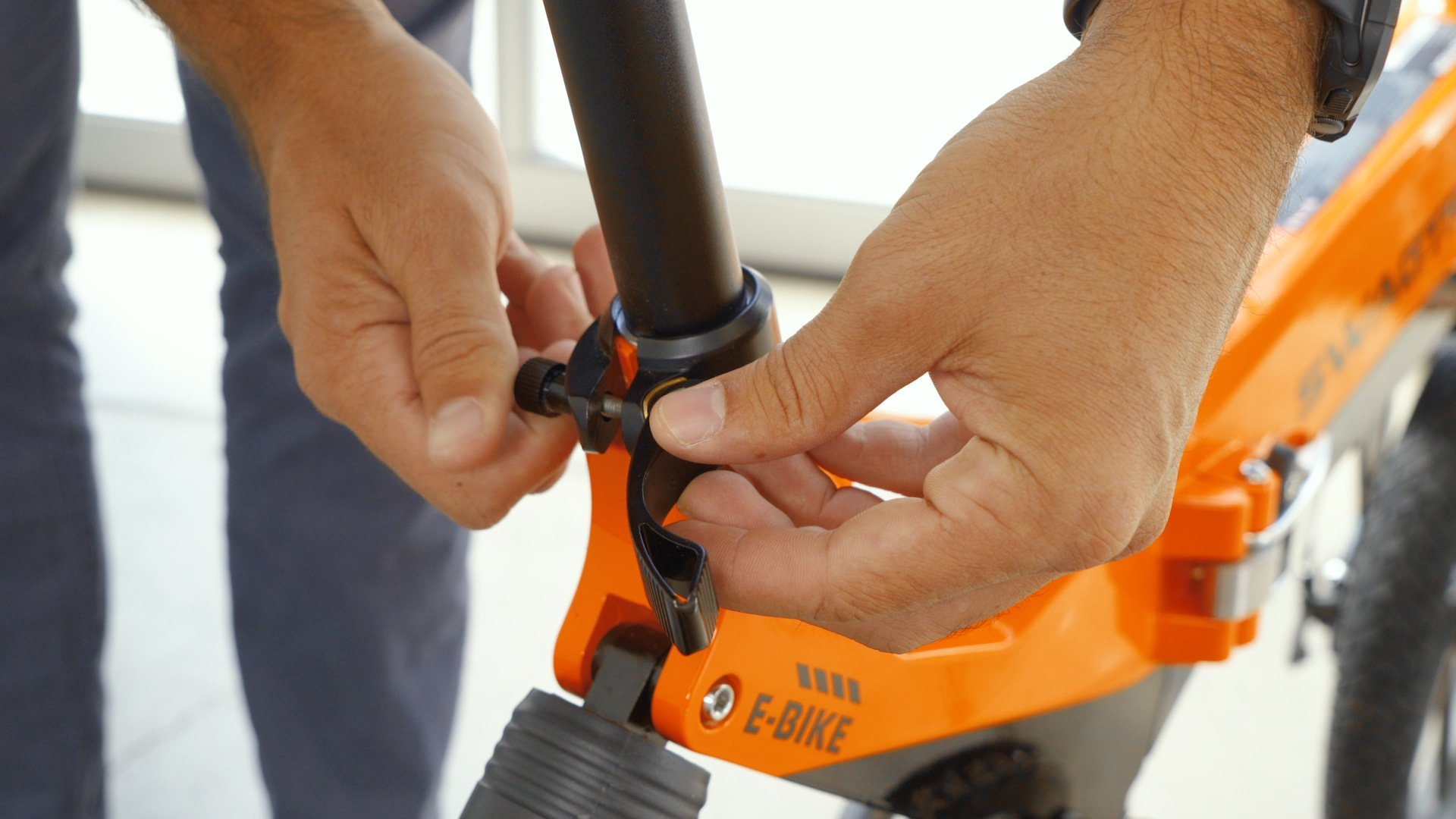 Closeup of man tightening the seat clamp.
