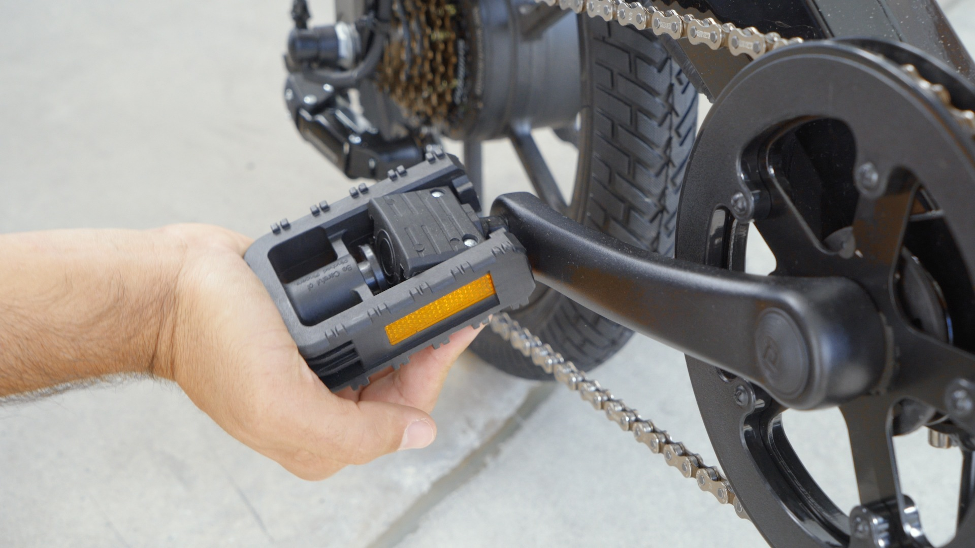Closeup of man folding out the pedals of the EB7 Plus.