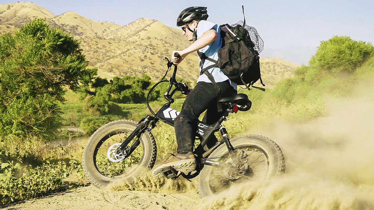 Man riding on a trail on his EB8 electric bike