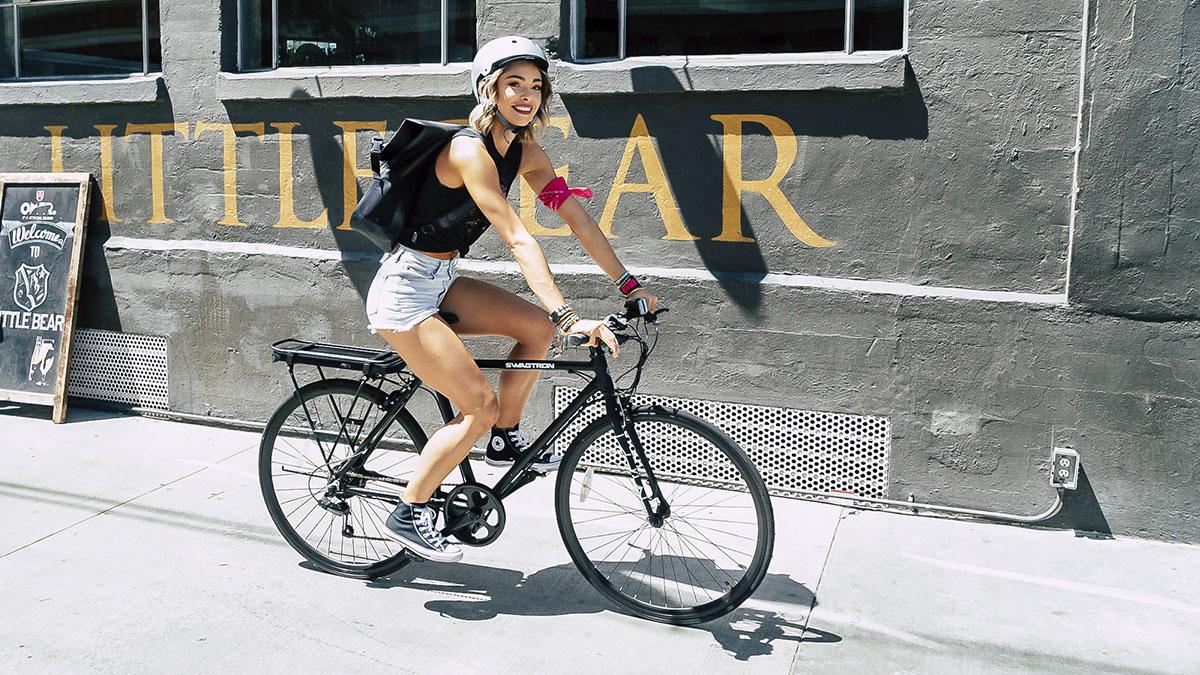 Smiling woman riding an EB12 eBike