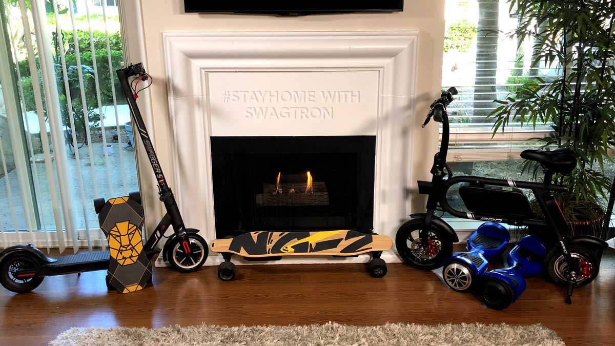 Indoors with SWAGTRON products resting against the fireplace. Stay Home, but Stay Entertained, with SWAGTRON.