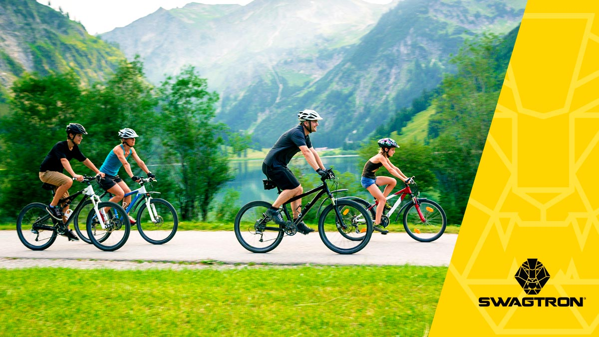 Family riding a scenic trail using their eBikes to help with Fitness.