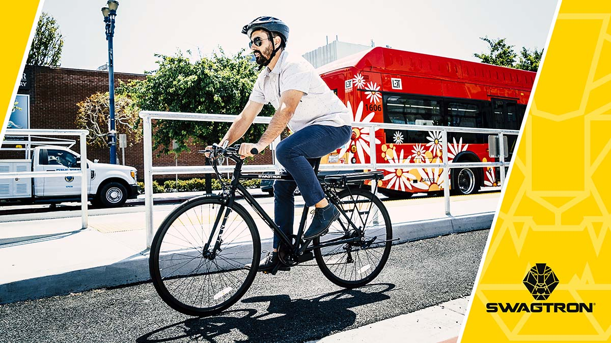 Man wearing a helmet riding an EB12 electric bike