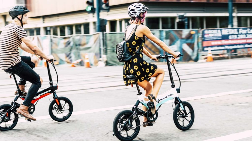 Couple wearing helmets and riding on their EB7 eBike.