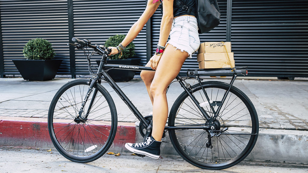 Close-up shot of a woman sitting on an EB12 electric bike.