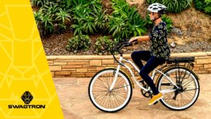 Older woman wearing a helmet while riding an EB9 electric bike.