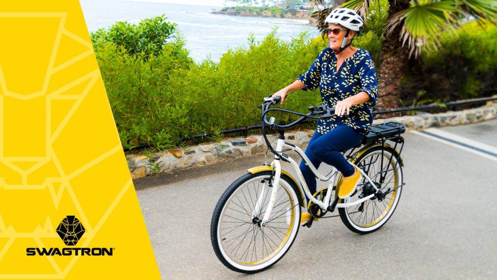 Older woman wearing a helmet, riding an EB10 Step-Through Cruiser eBike.