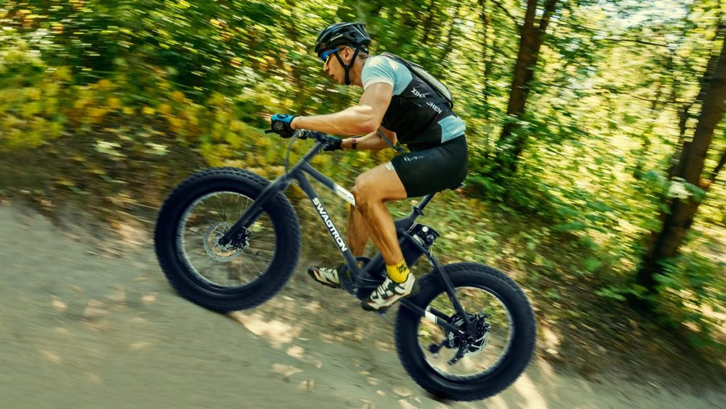 Older man riding on an uphill trail with his EB8 Fat-Tire eBike.