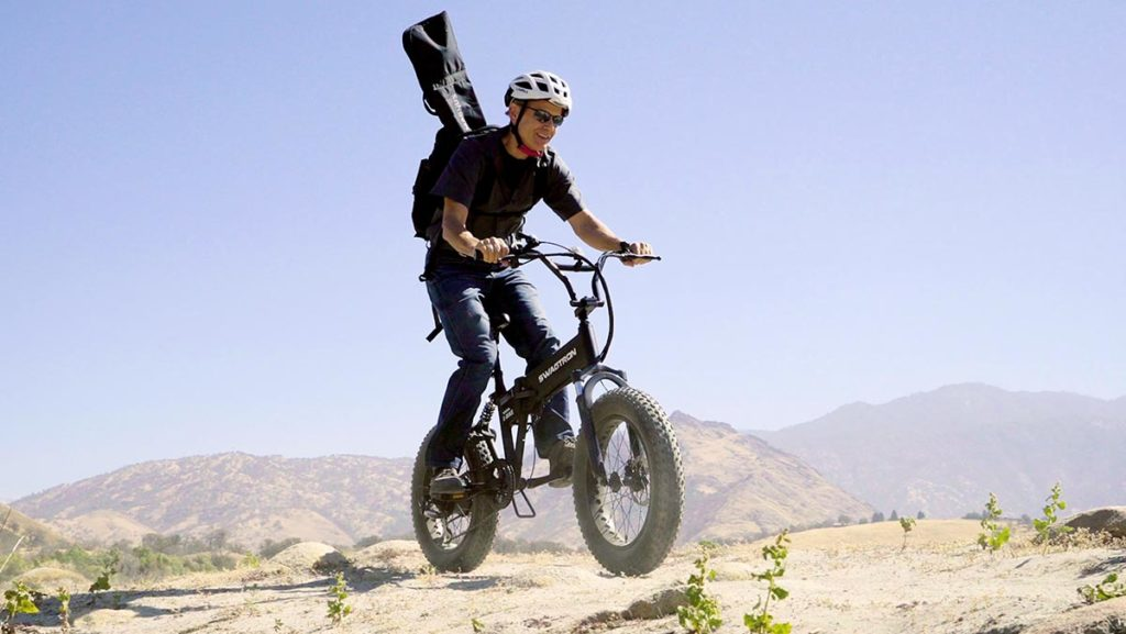 Older man riding on rough terrain on his EB8 Fat-Tire eBike.