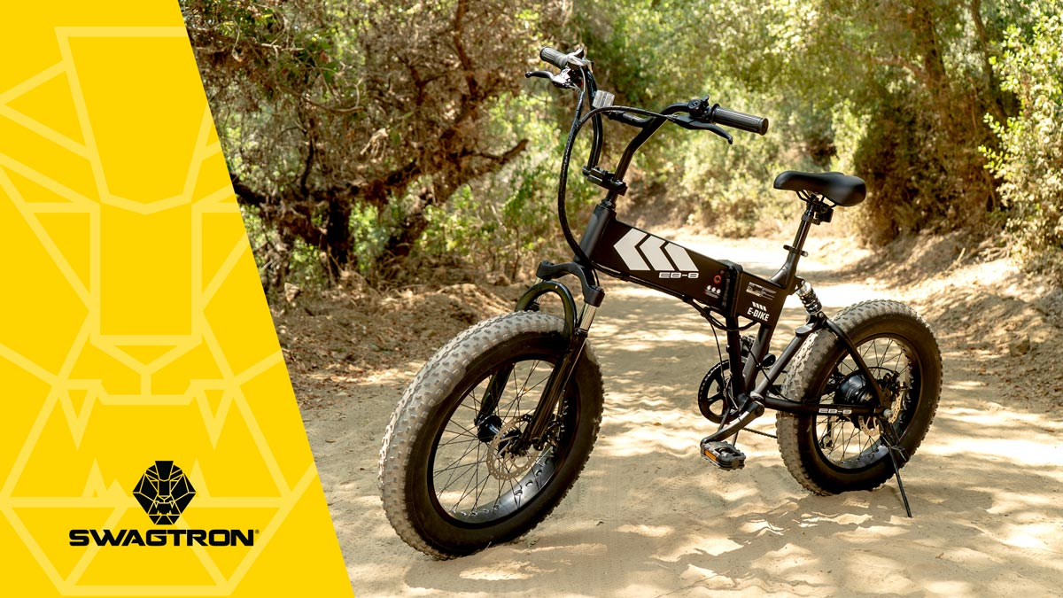 Side view of the EB8 Fat-Tire Electric Bike from SWAGTRON, standing outside in a dirt trail.
