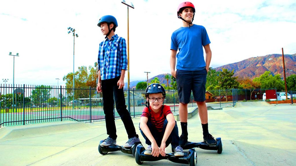Three young kids standing on their swagBOARD T5 hoverboards.