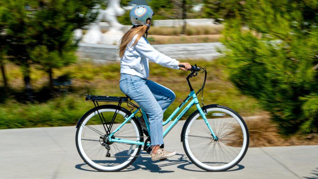 Woman riding an EB9 Step-Through electric bike.