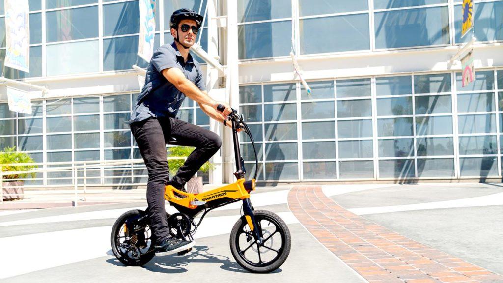 Man wearing helmet riding the EB7 Plus eBike.