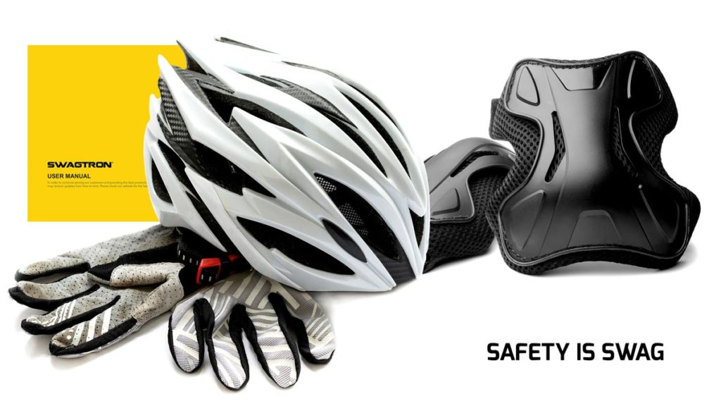 Image of riding gloves, Livall helmet and knee pads.