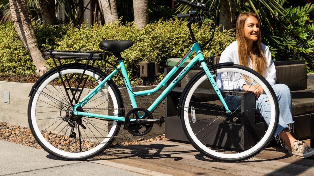 Woman sitting next to her EB9 electric bike.