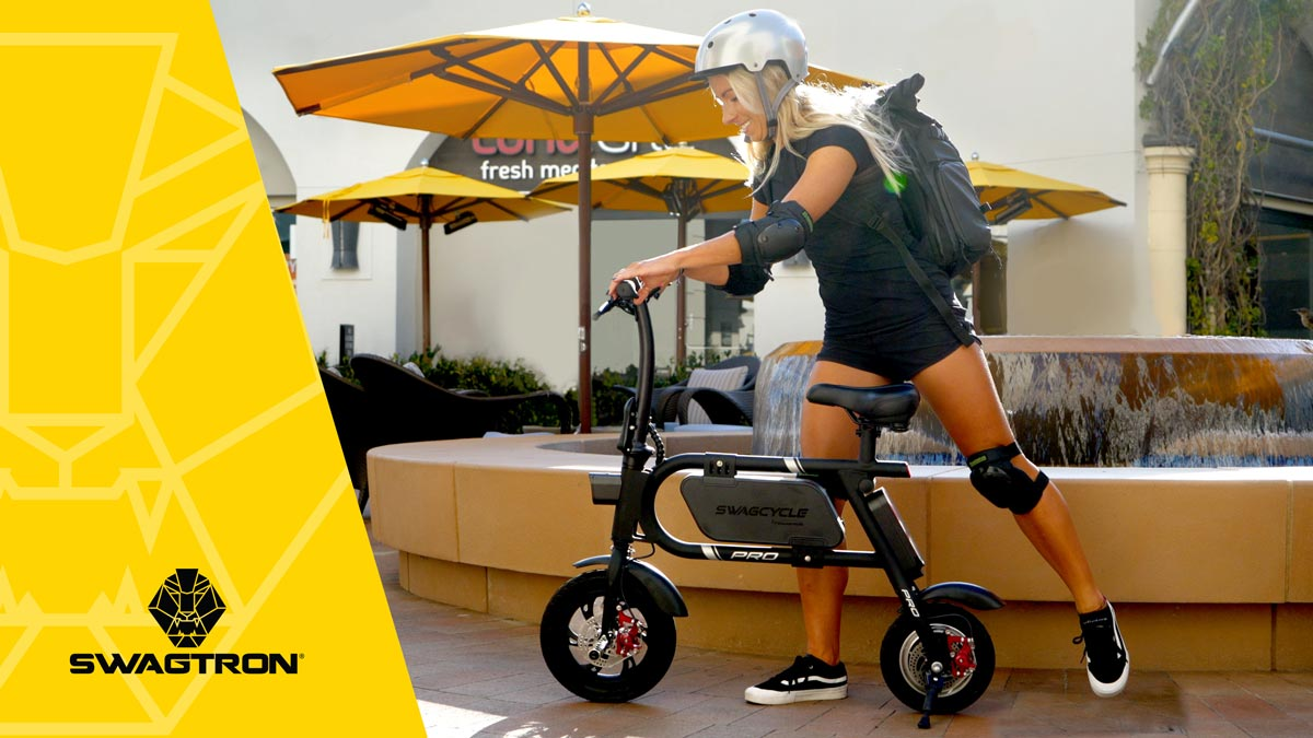 Woman wearing a helmet and getting on her swagCYCLE Pro eBike.