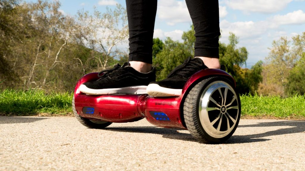 Close-up of the swagBOARD T1 hoverboard with someone riding it.