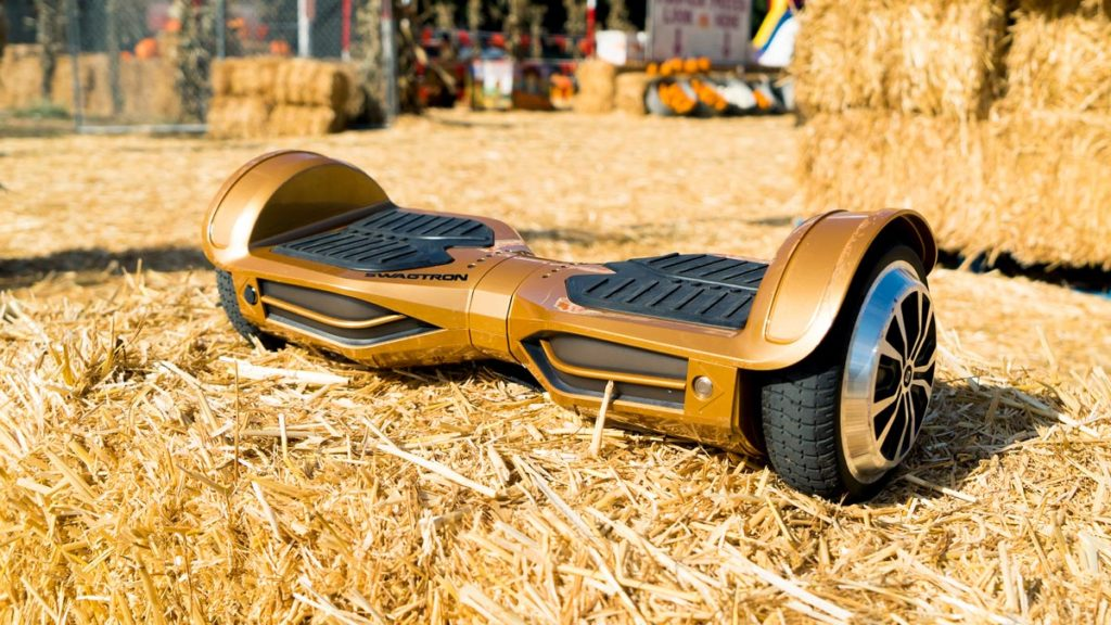 The swagBOARD T380 hoverboard atop a stack of hay.