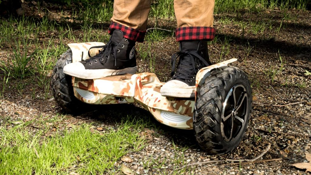 Closeup of man standing on the camouflage swagBOARD T6 hoverboard.