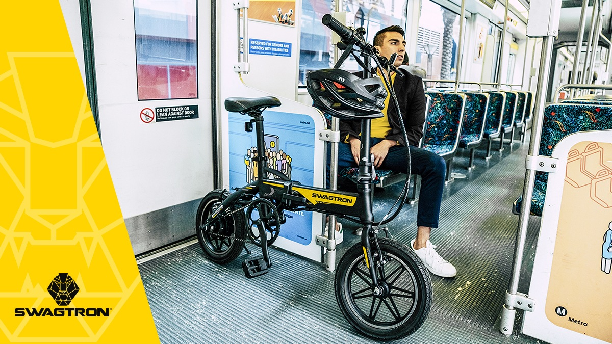 Guy sitting on the bus with his EB5 eBike.