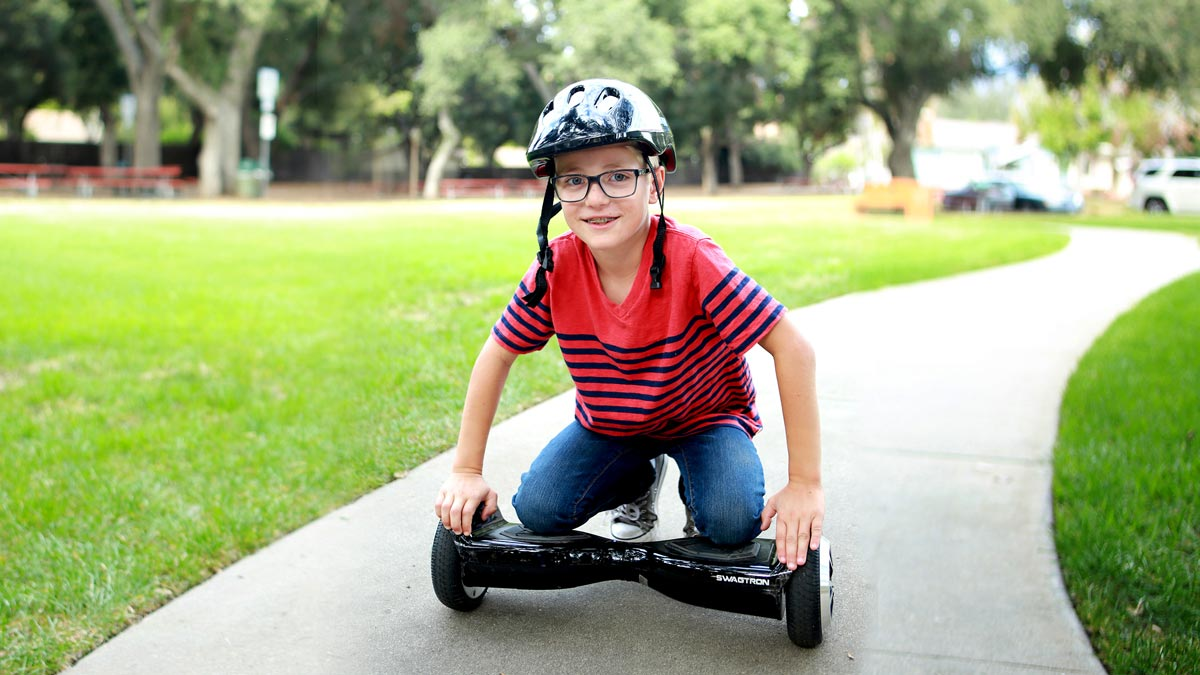 Kid kneeling on a swagBOARD T5 Classic.