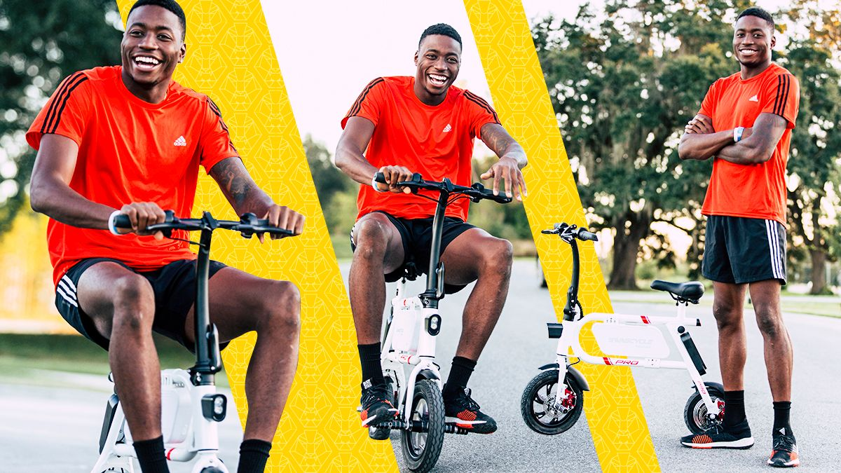 Split image of Grant Holloway on a swagCYCLE Pro.