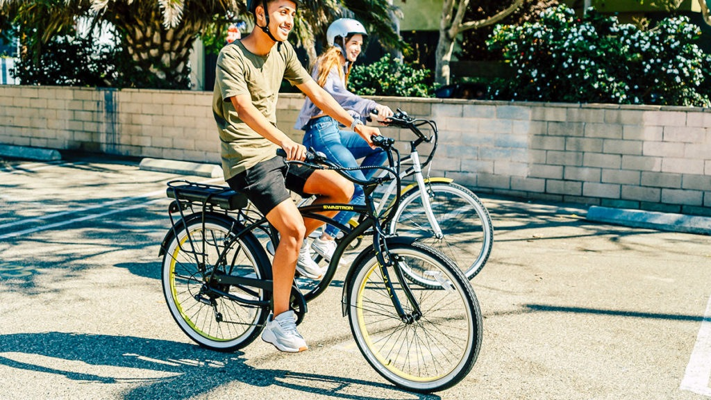 Couple wearing helmets, both riding their own EB11 eBike.