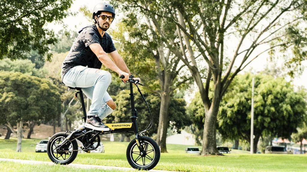 Man wearing helmet riding the EB7 Plus electric bike.