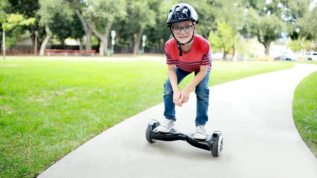 Kid riding on his swagBOARD T5 Classic.