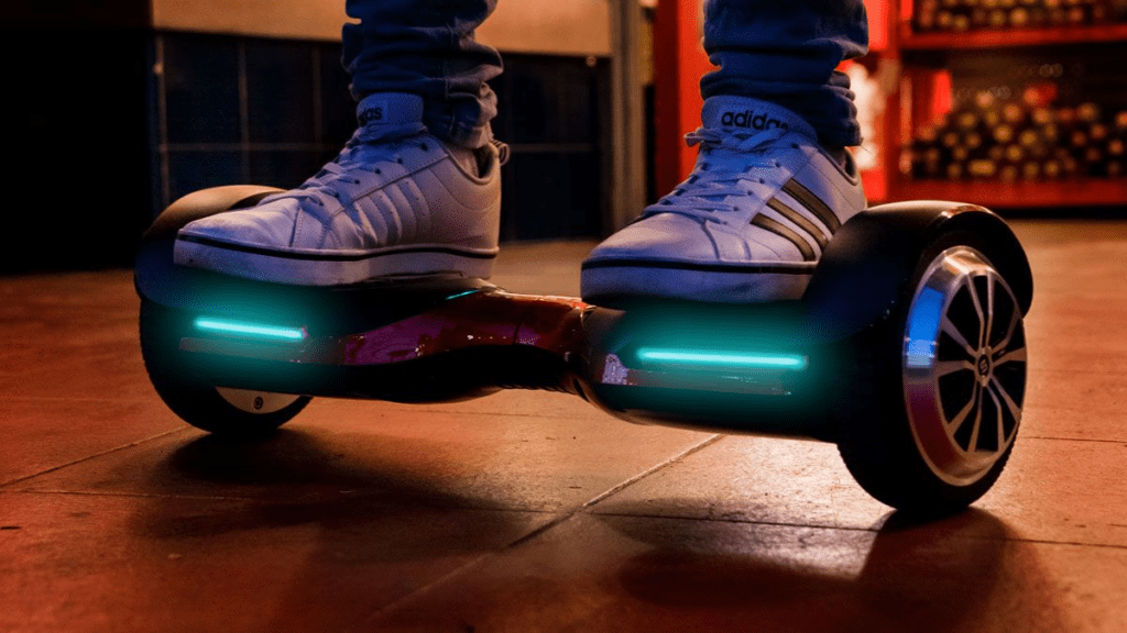 Close-up of teen standing on the swagBOARD T580 Vibe hoverboard.