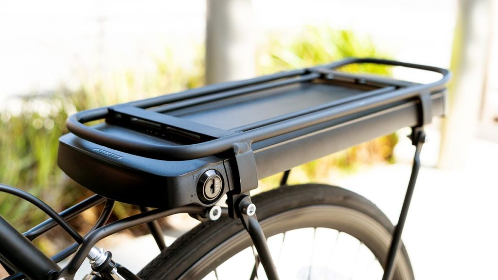 Closeup of the bike rack with removable battery of some SWAGTRON EB-Series eBikes.