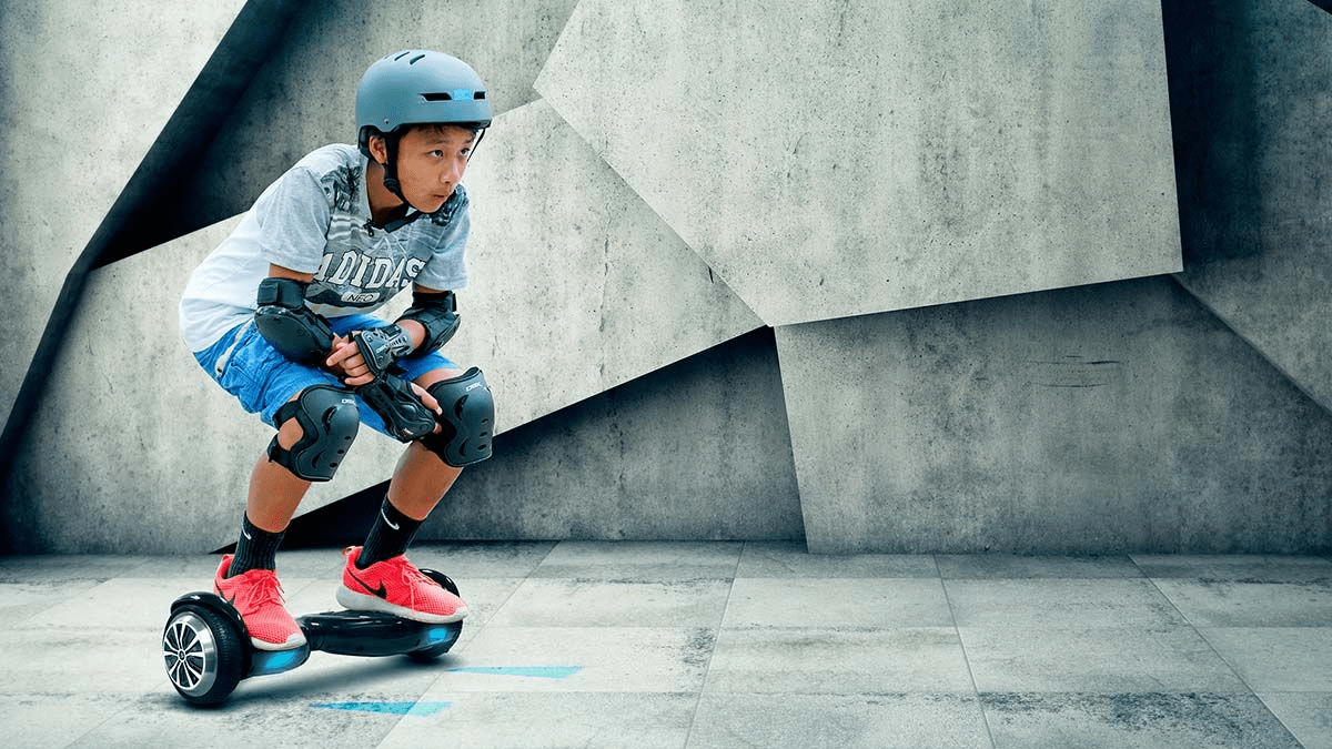 Young kid squatting down while riding his swagBOARD T1 Pro hoverboard.