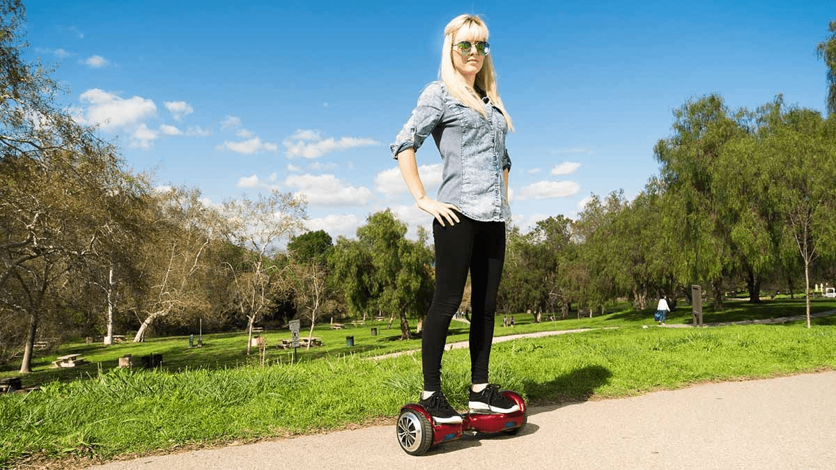 Woman demonstrating perfect posture while standing on a swagBOARD T1 hoverboard.