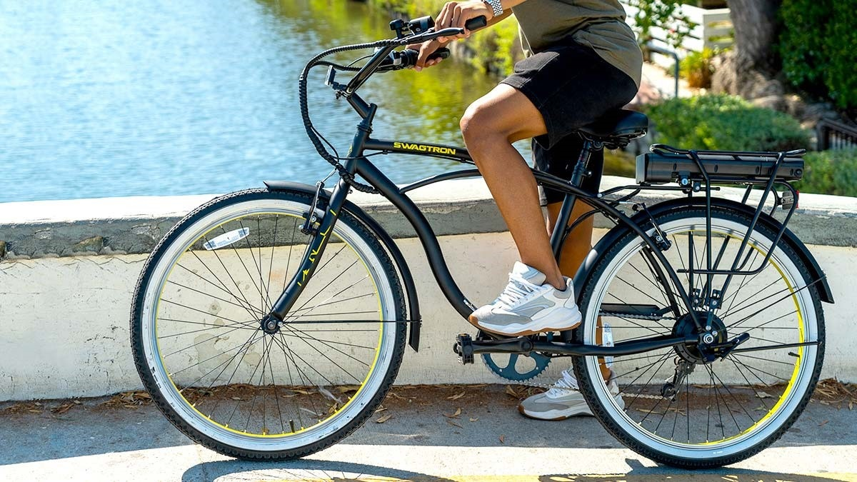 Close-up of woman riding the EB11 Cruiser eBike.