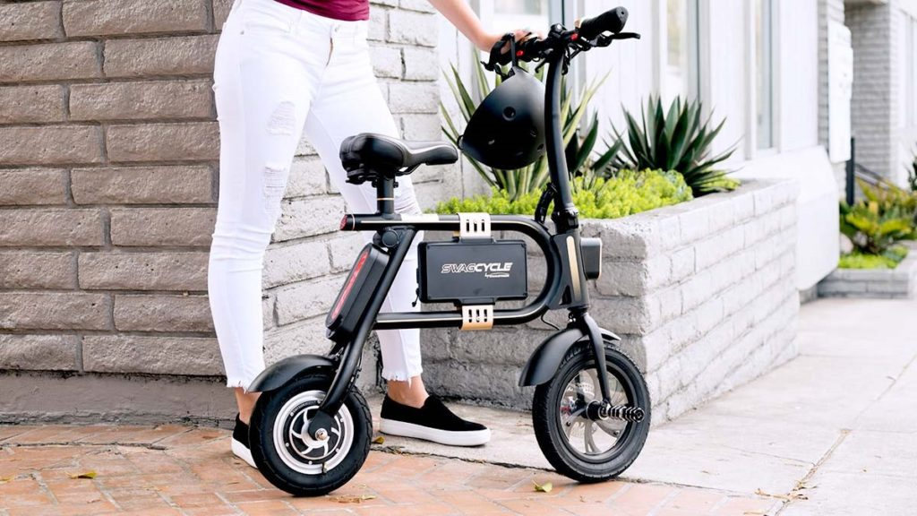 Woman standing next to her swagCYCLE Classic eBike.