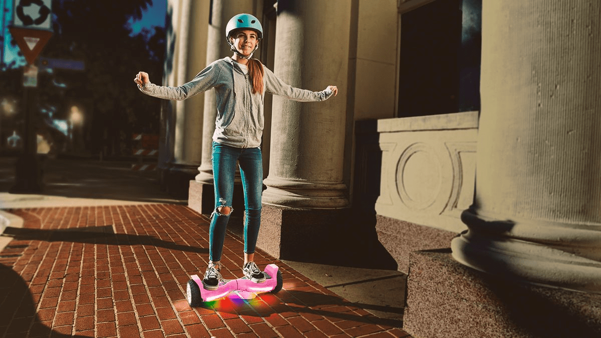 Woman riding the T580 Warrior Bluetooth hoverboard.