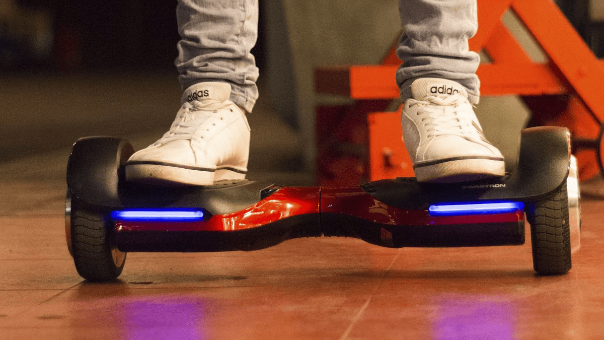 Close-up of man riding on a swagBOARD T580 Vibe hoverboard.